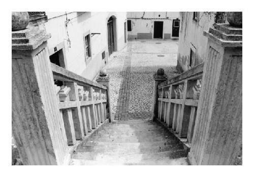 Paisagem Urbana/O pátio das escadas