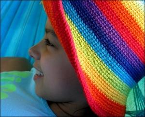 /Com o arco-iris no chapéu