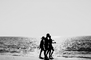 Outros/Three Persons in the sand