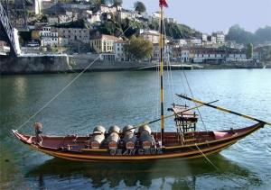 Paisagem Urbana/O barco  rabelo ante a cidade...