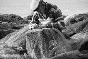 /Pescador preparando a faina