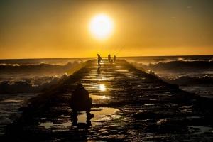 /à pesca do pôr-do-sol