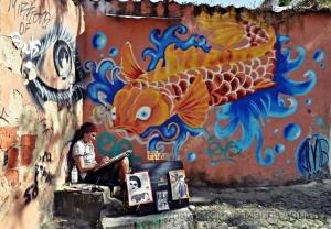 Paisagem Urbana/A pintora concentrada e a carpa curiosa