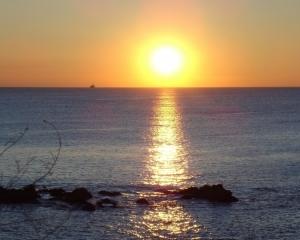 /Fim de tarde junto ao mar