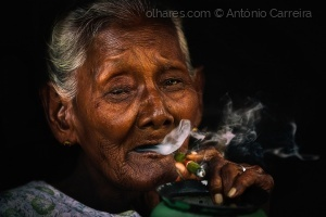 /The grandmother smokes a lot